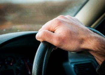 Hand on power streering wheel